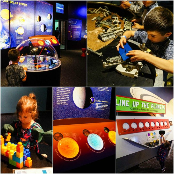 Space Link exhibit with images of planets and legos at the Maryland Science Center.