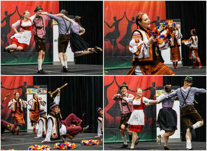 Carpathian Folk Dance Ensemble on the stage dancing in traditional Central and Eastern European costumes.