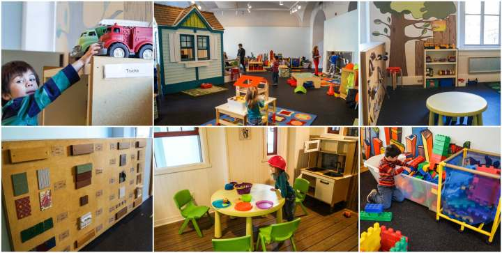 Playing with trucks and in a play kitchen at the Building Zone exhibit.