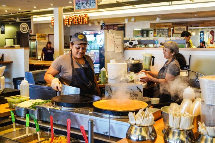 Two women at the DC Dosa stand in Union Market