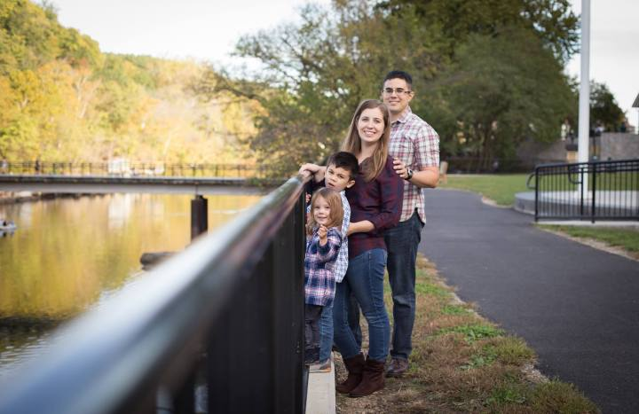 Family four with four people standing next to a river in Occoquan, Virginia.