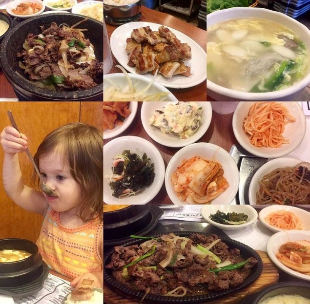 Spread of banchan, grilled meat, and soup at Nak Won Restaurant.