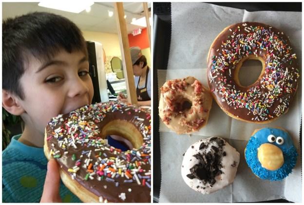 Eating a large doughnut at Texas Donuts.