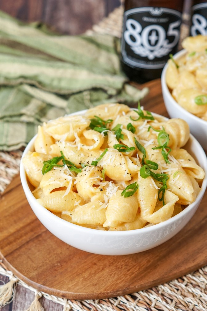 Close up of Beer Mac and Cheese topped with green onions.