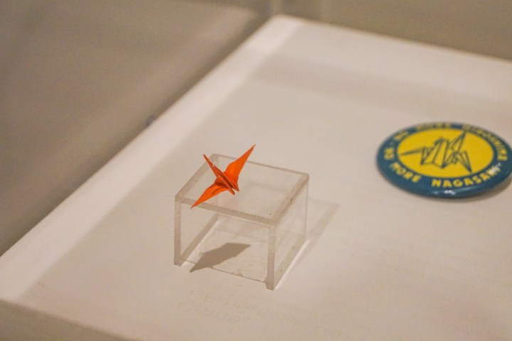 Sadako's crane on display- a small red origami crane.