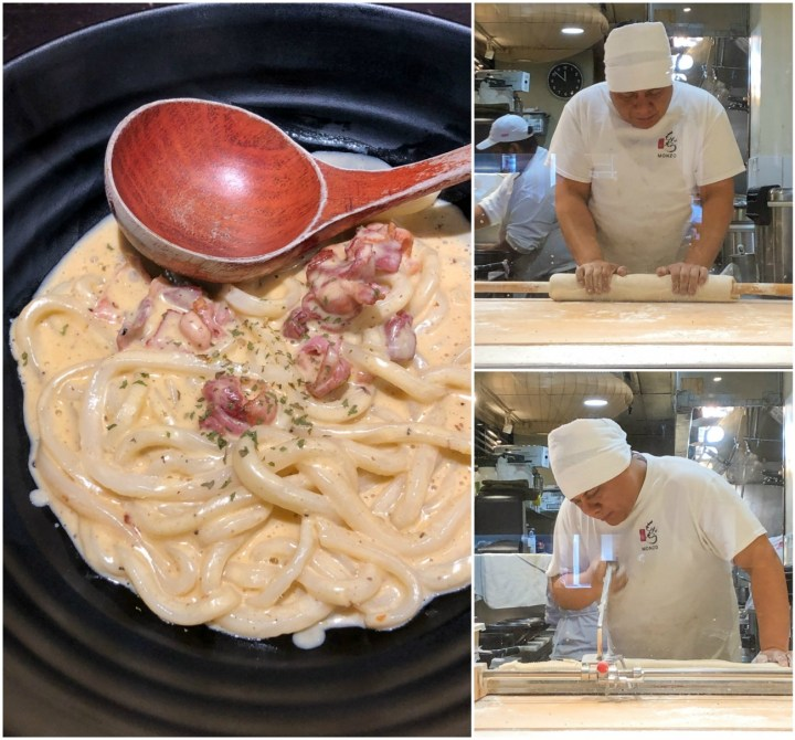 Miso Carbonara Udon in a large black bowl with a wooden spoon and man rolling out udon at Marugame Udon
