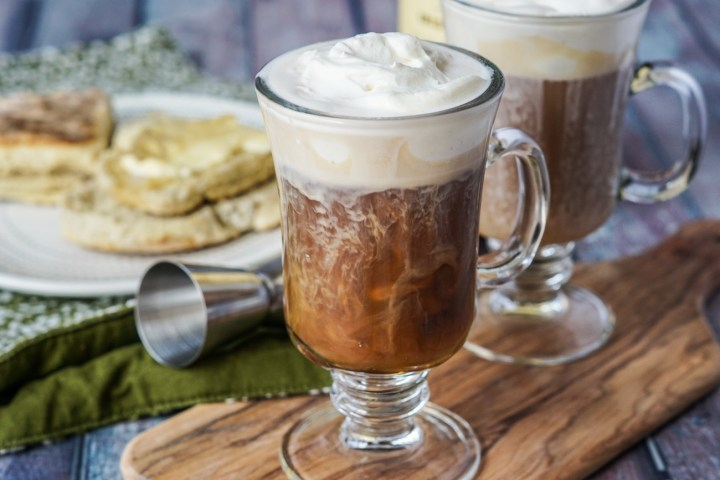 Irish Coffee in two glass mugs and topped with whipped cream.