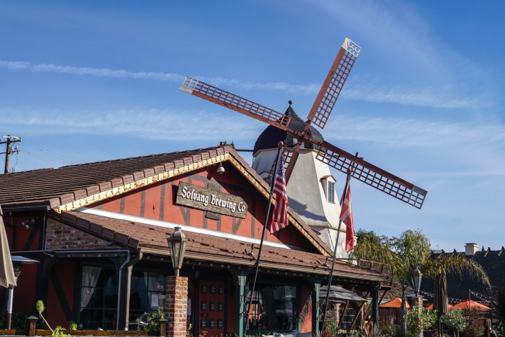 Solvang Brewing Co with a windmill in the background.