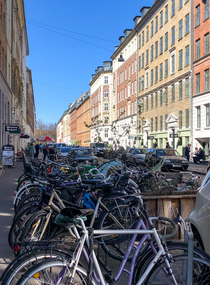 Street view of Jægersborggade lined with bicycles.