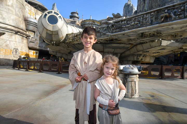 Standing in front of the Millennium Falcon