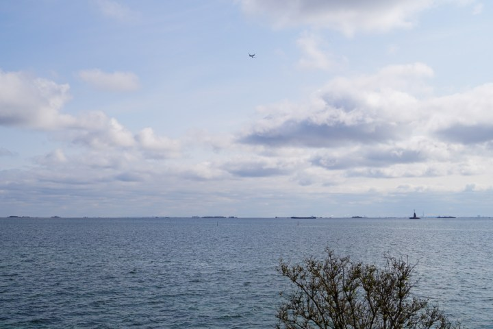Plane flying over the water- Øresund