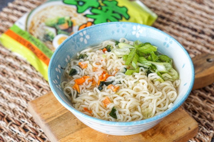 Healthy Vegetable Ramen topped with sliced green onions in a light blue bowl with white flowers.