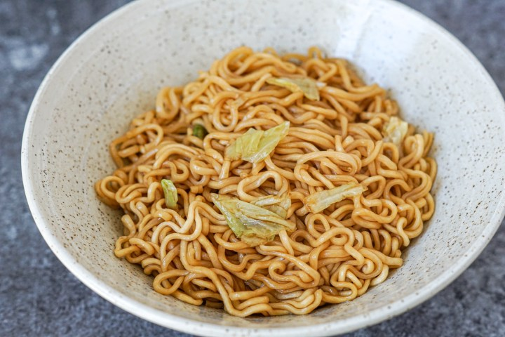 Asakusa Sauce Yakisoba noodles with cabbage in a light grey bowl.