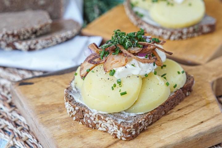 Kartoffelmad (Danish Potato Sandwich) on a board