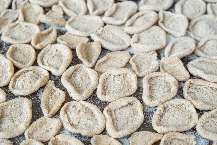 Orecchiette al Grano Arso (Toasted-Flour Orecchiette) in a single layer on a pan