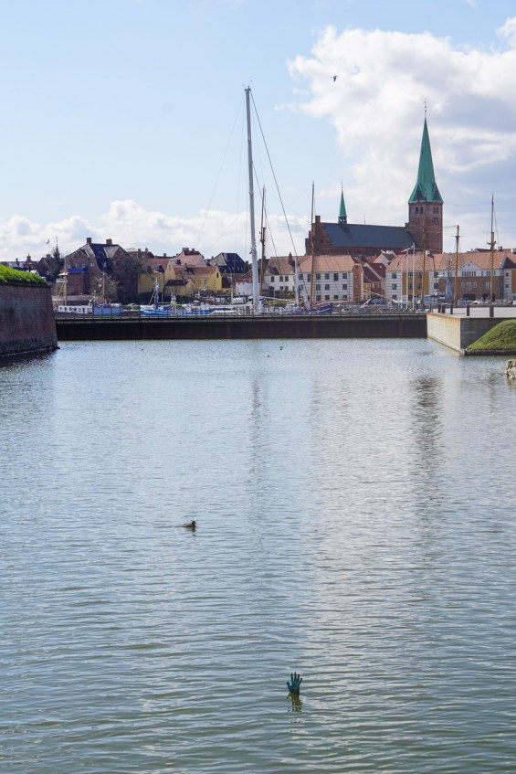 Moat outside of Kronborg Slot with the statue of a hand sticking out of the water.