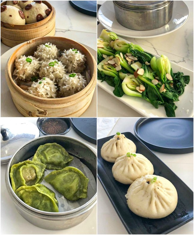 Meatball dumplings covered in sticky rice, Steamed Bok Choy topped with almonds, green dumplings, and white dumplings on a black plate at Qi Steam Kitchen
