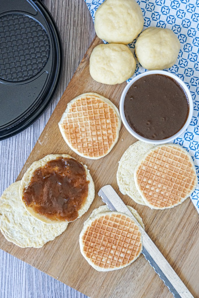Aerial view of forming the Gaufres Fourrées (Little Sugar Waffles). Balls of dough, sugar filling, and cutting the waffles in half with a serrated knife.