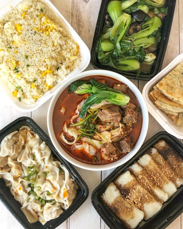 Take out from Ruiji Sichuan Cuisine- Sichuan Knife-Cut Wheat Noodle Beef Soup, Wonton in Chili Sauce, Egg Fried Rice, Sautéed Bok Choy and Shiitake Mushroom, Scallion Pancakes, and Fried Sticky Rice Cake with Brown Sugar.