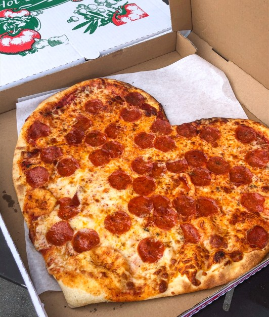 Large Heart-shaped pepperoni pizza from Mickey's Deli.