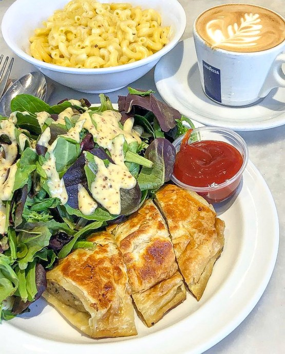 Sausage roll, salad, macaroni and cheese, and coffee from Gum Tree Cafe.