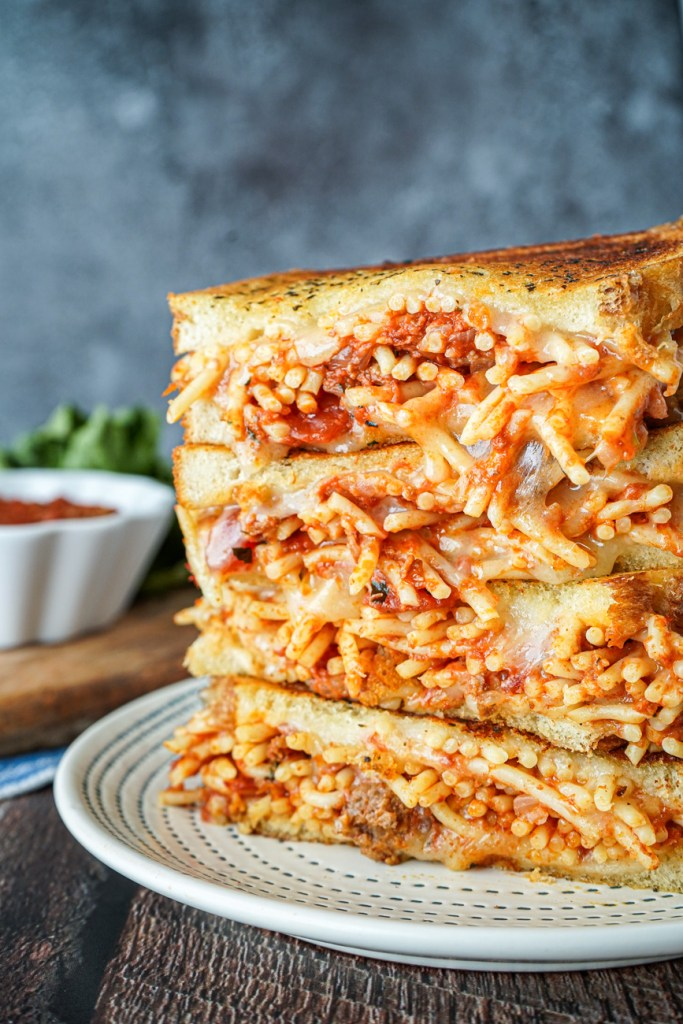 Stacked halves of Spaghetti Grilled Cheese.