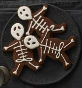 black plate with chocolate skeleton cookies