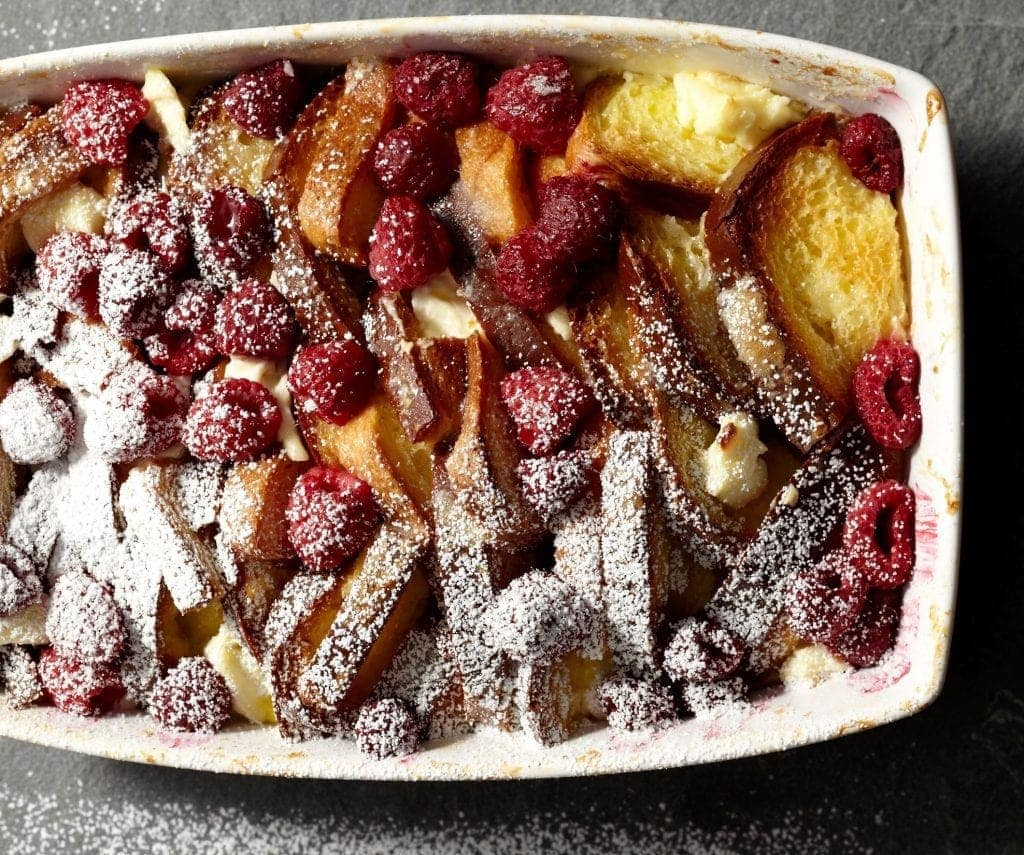 Raspberry French Toast Strata is tangy raspberries and sweet cream custard stuffed into light and airy French toast, all baked in one dish.