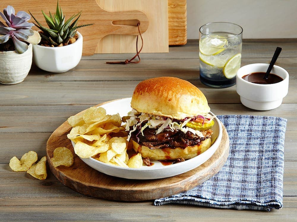 Slow Cooker Brisket Sandwich on table Tara Teaspoon