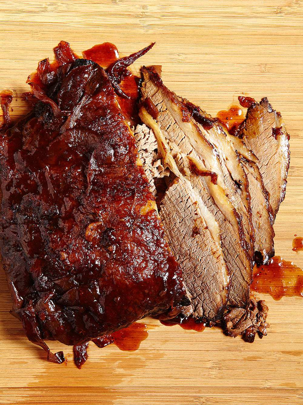 Slow Cooker Brisket Sandwich sliced on a cutting board Tara Teaspoon