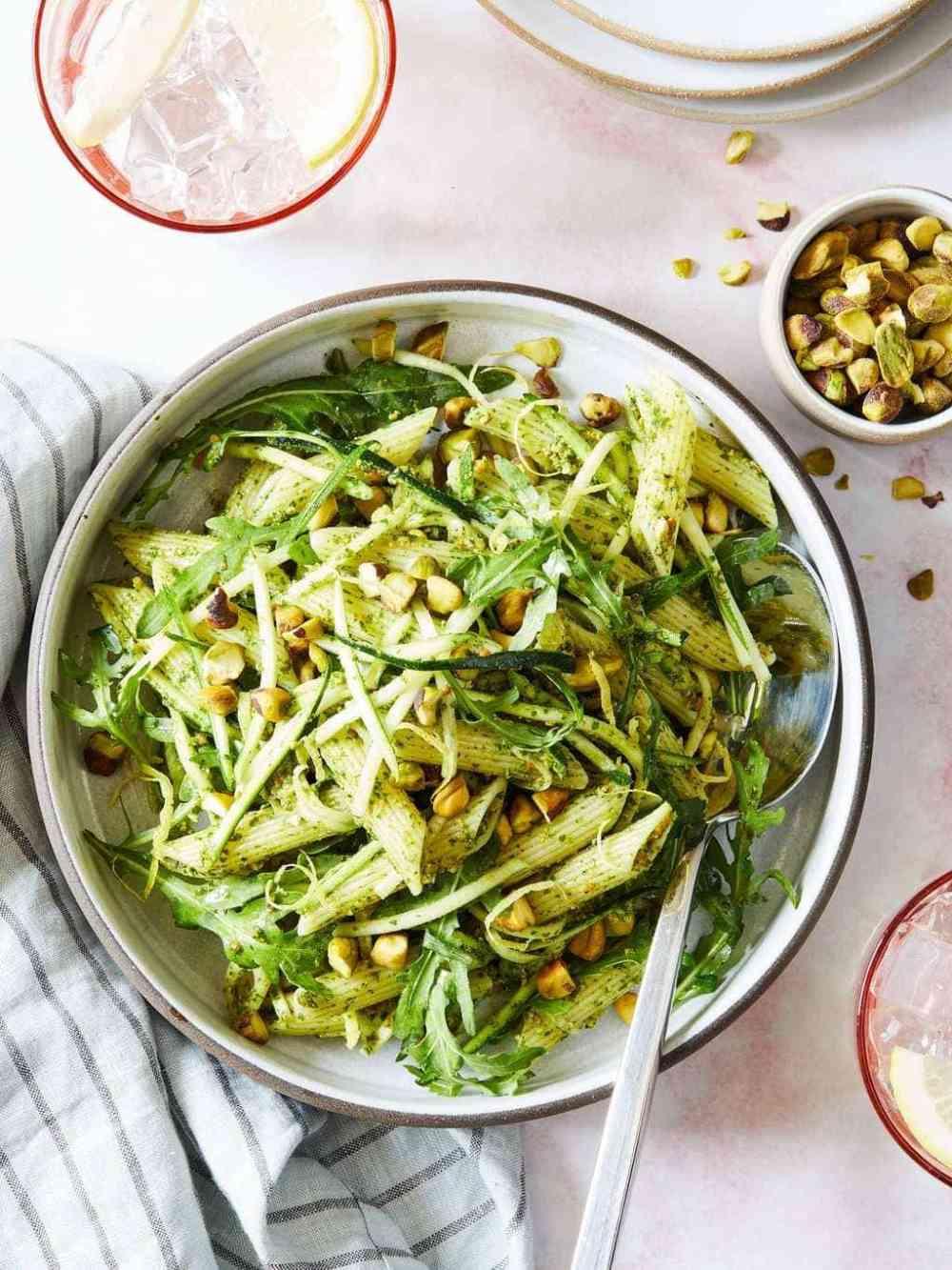Close up of pistachio pesto pasta with green pistachios