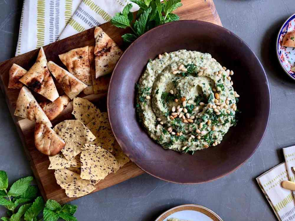 grilled zucchini baba ghanoush dip in a bowl with pita