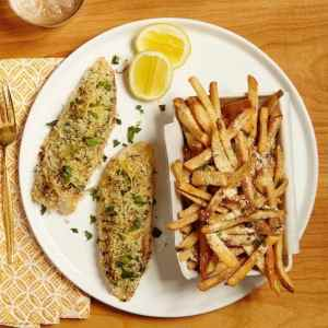 Crispy Lemon Fish on a plate with Parmesan Fries