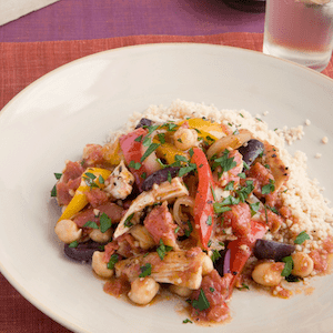 Moroccan chicken stew with couscous on a plate