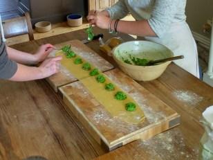 Making pea and ham raviloi