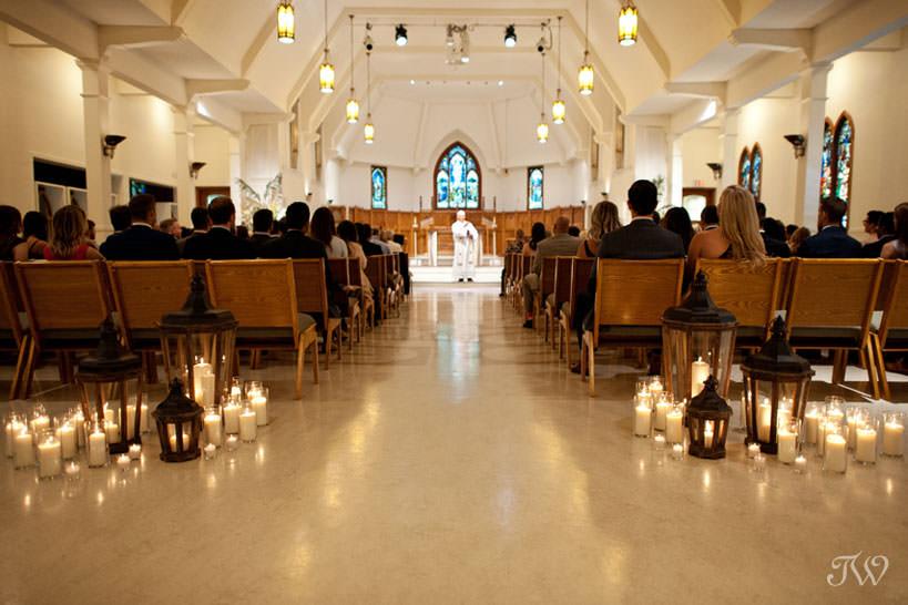 candles at St Stephen's Church captured by Calgary wedding photographer Tara Whittaker