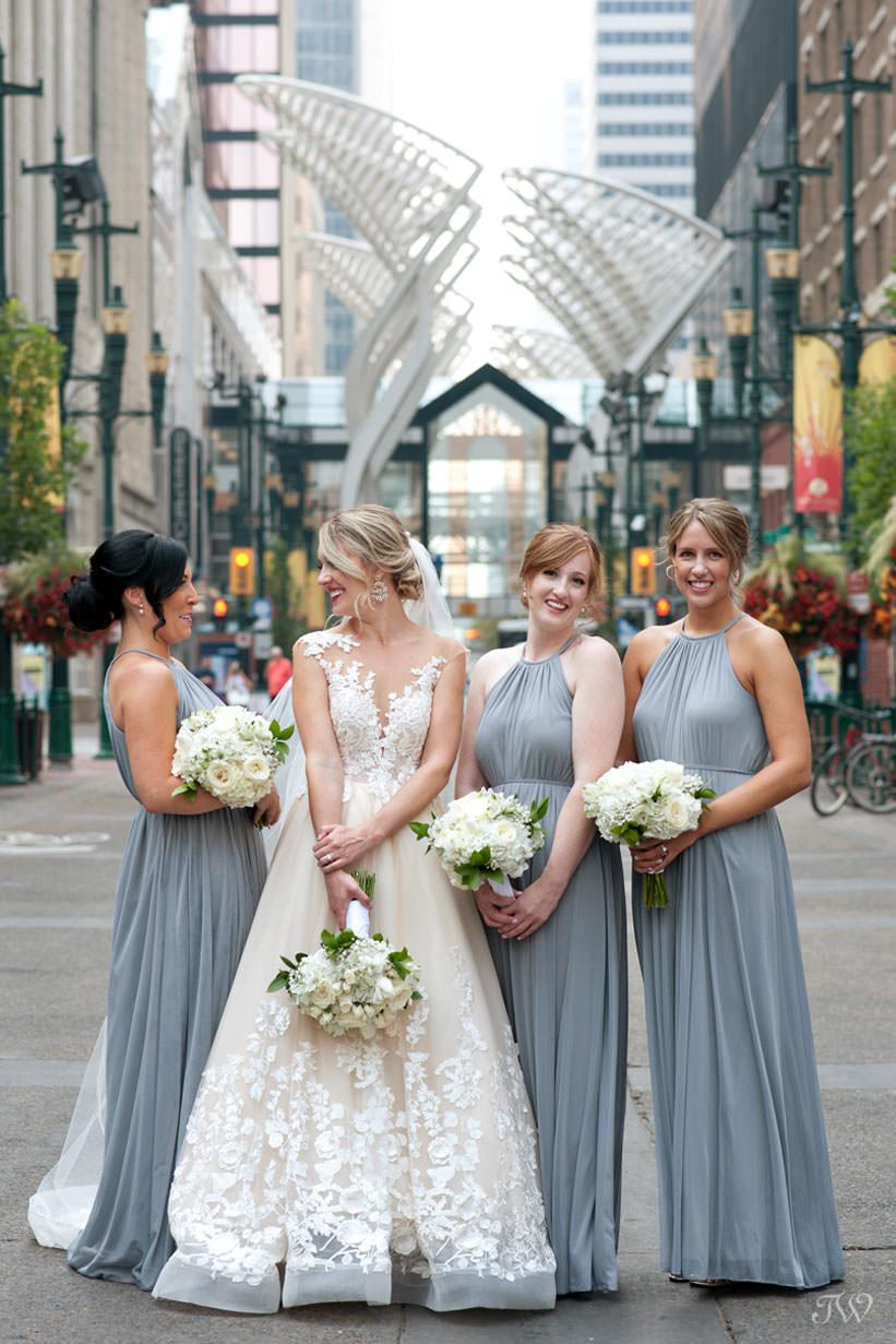 bridal party on Stephen Avenue captured by Calgary wedding photographer Tara Whittaker