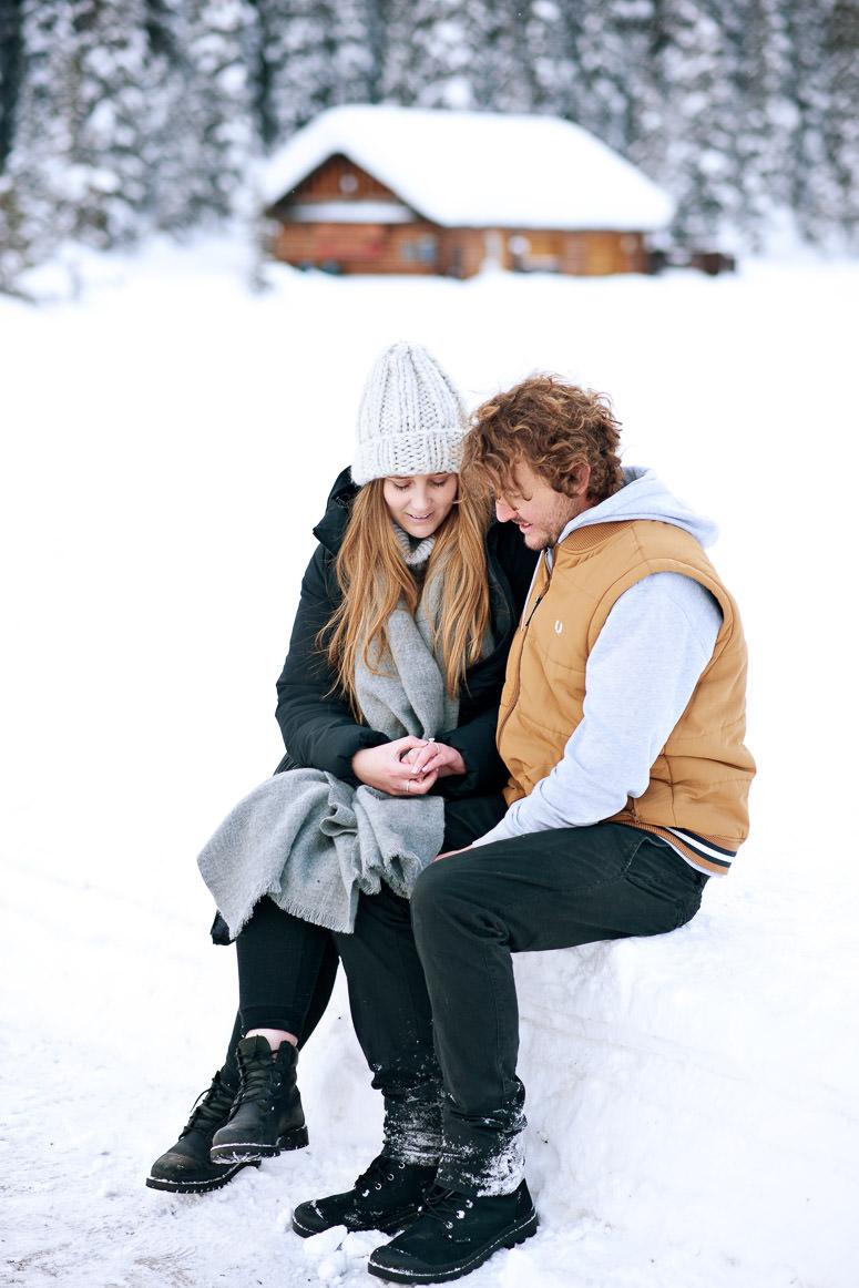 bride admiring her new engagement ring Calgary engagement photography by Tara Whittaker