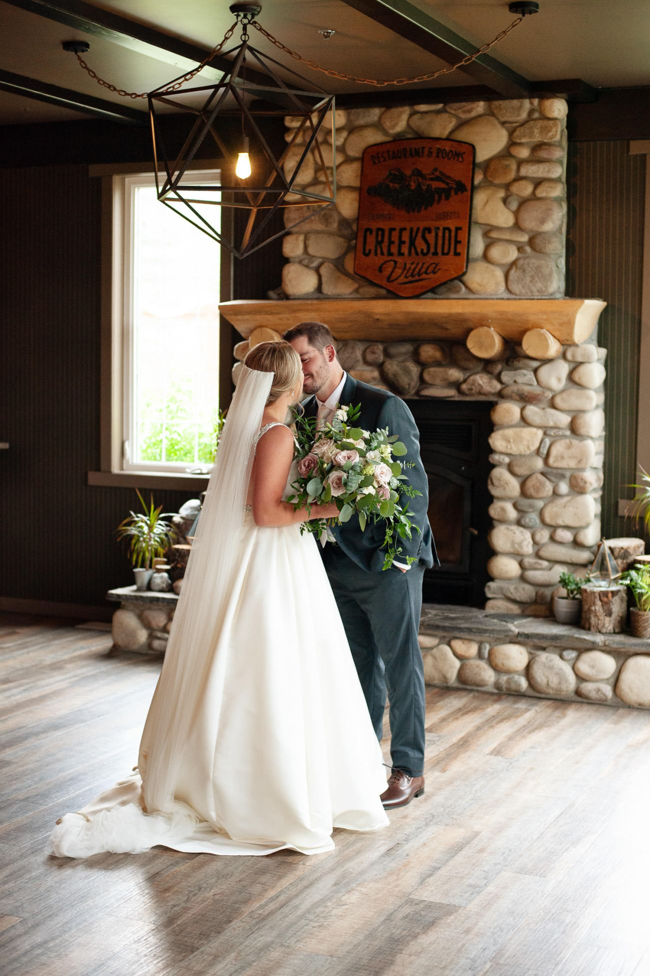 Bride and groom kiss during first look at Creekside Villa wedding captured by Tara Whittaker Photography