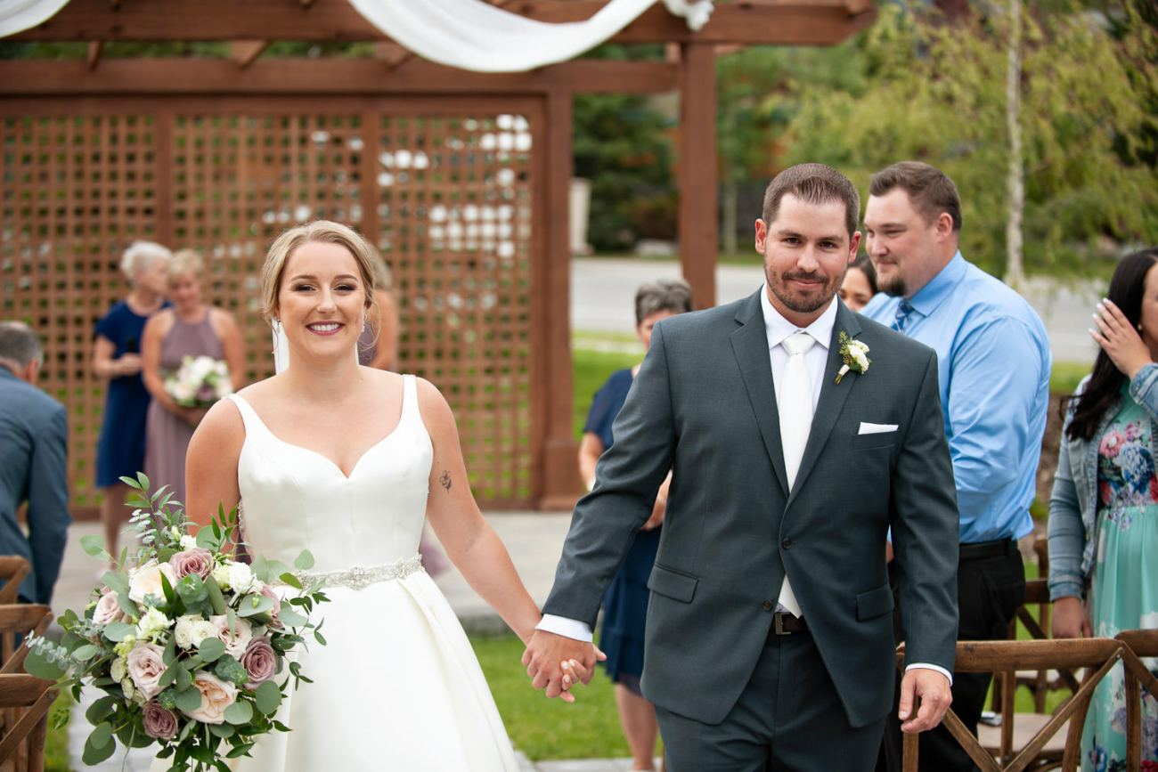 Happy bride and groom after their Creekside Villa wedding captured by Tara Whittaker Photography