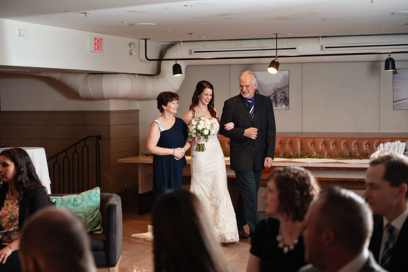 Bride walks down the aisle at her intimate wedding in Calgary captured by Tara Whittaker Photography