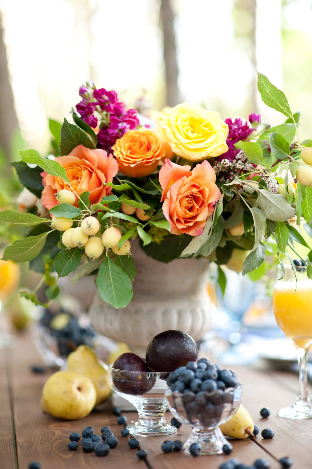 Plums, pears and blueberries on a brunch table captured by Tara Whittaker Photography