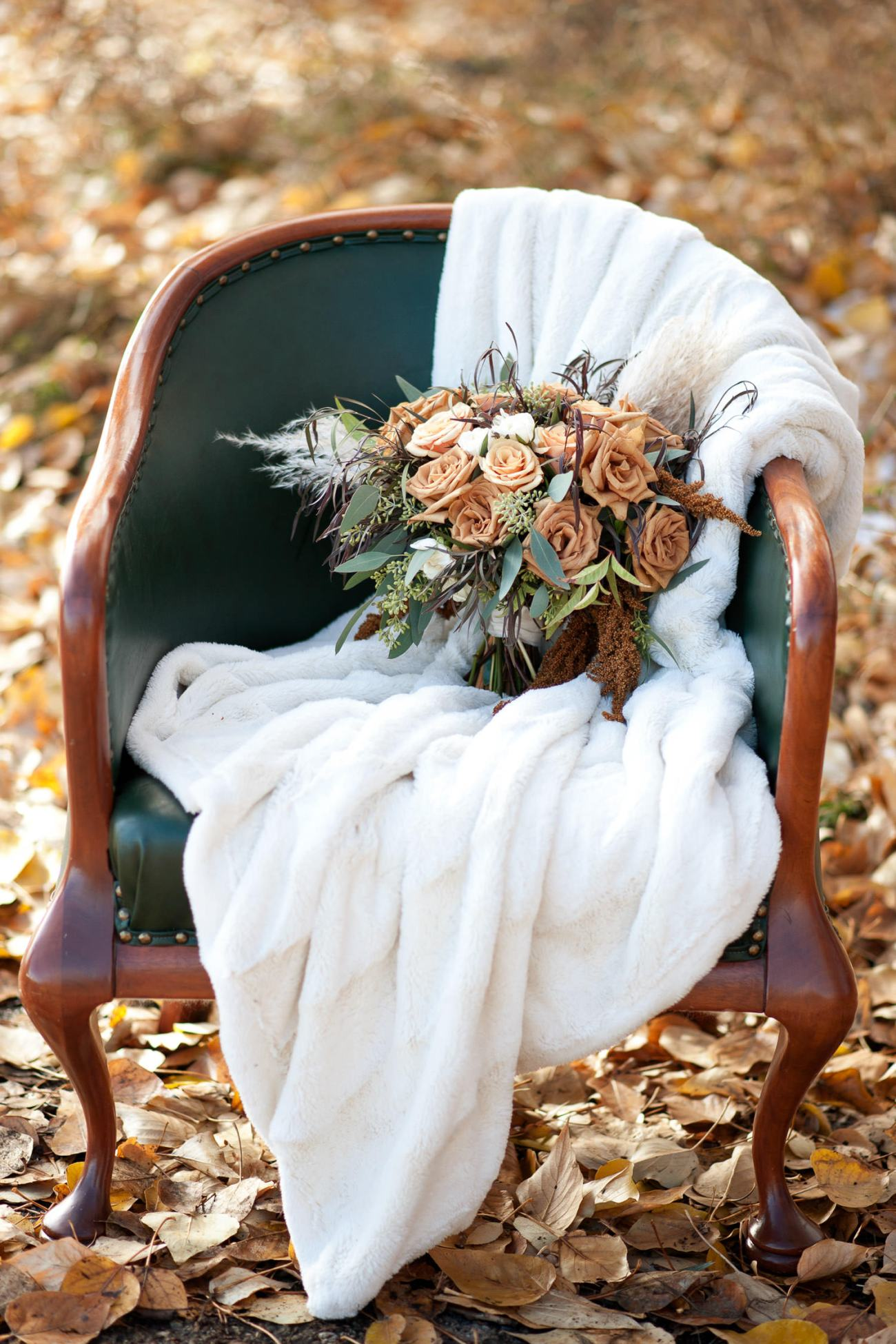 fall bouquet sits among the leaves captured by Tara Whittaker Photography