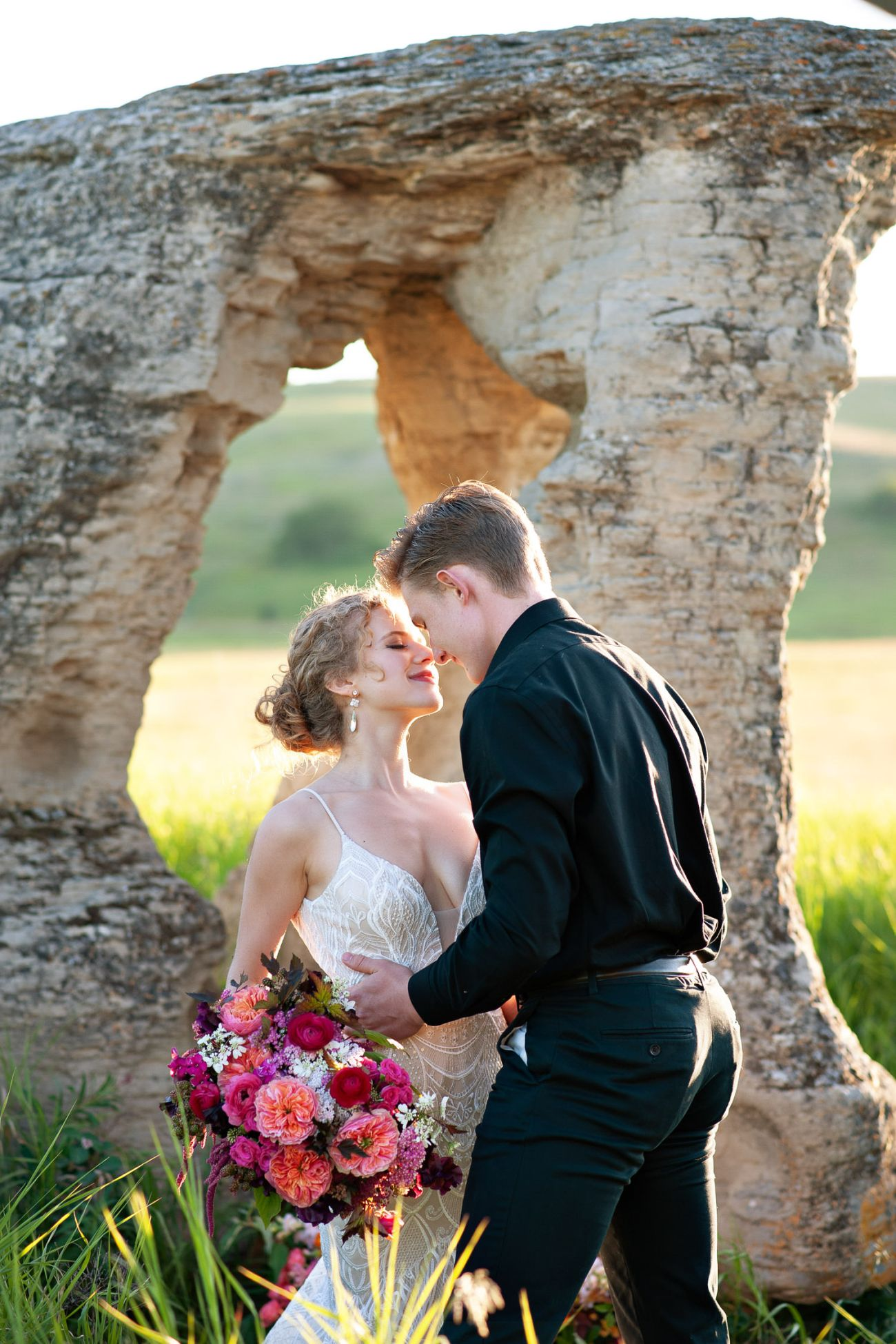bride and groom kiss at their fall wedding captured by Tara Whittaker Photography