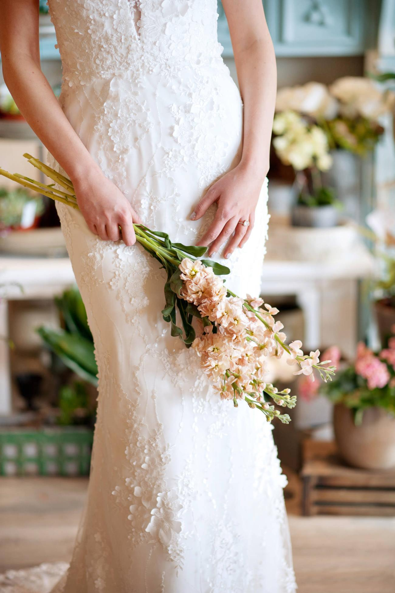 Close-up of the floral lace on bride's Lis Simon bridal gown captured by Tara Whittaker Photography