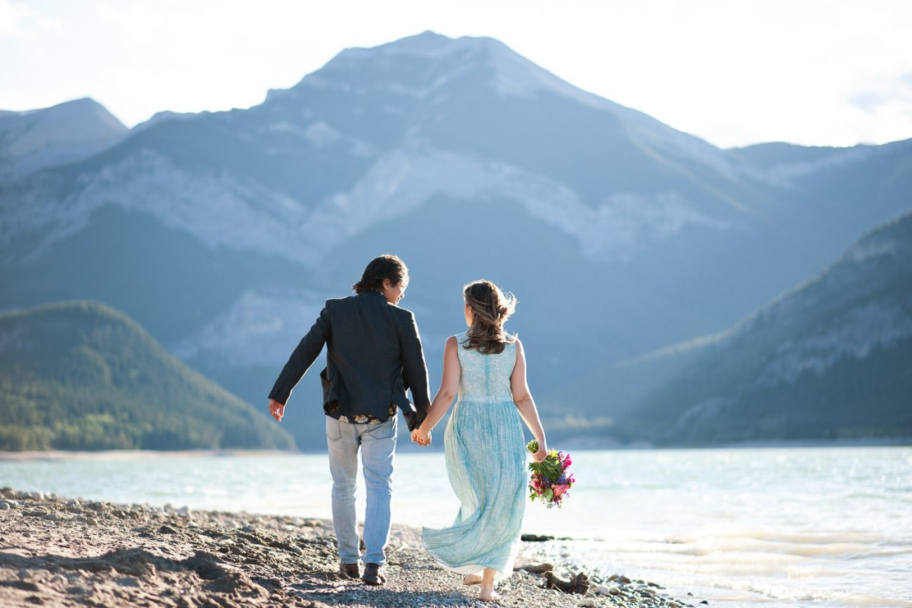couple strolling on shore of Barrier Lake captured by Tara Whittaker Photography