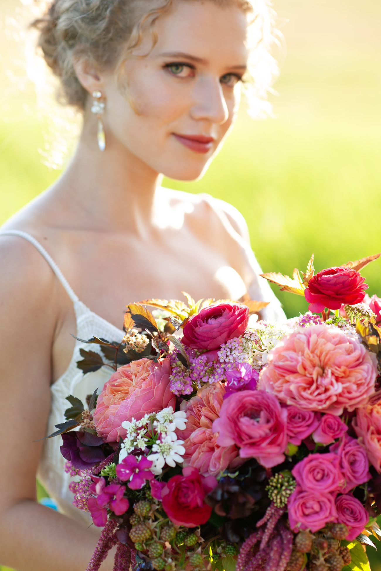 bride carries a bouquet of pink roses captured by Tara Whittaker Photography