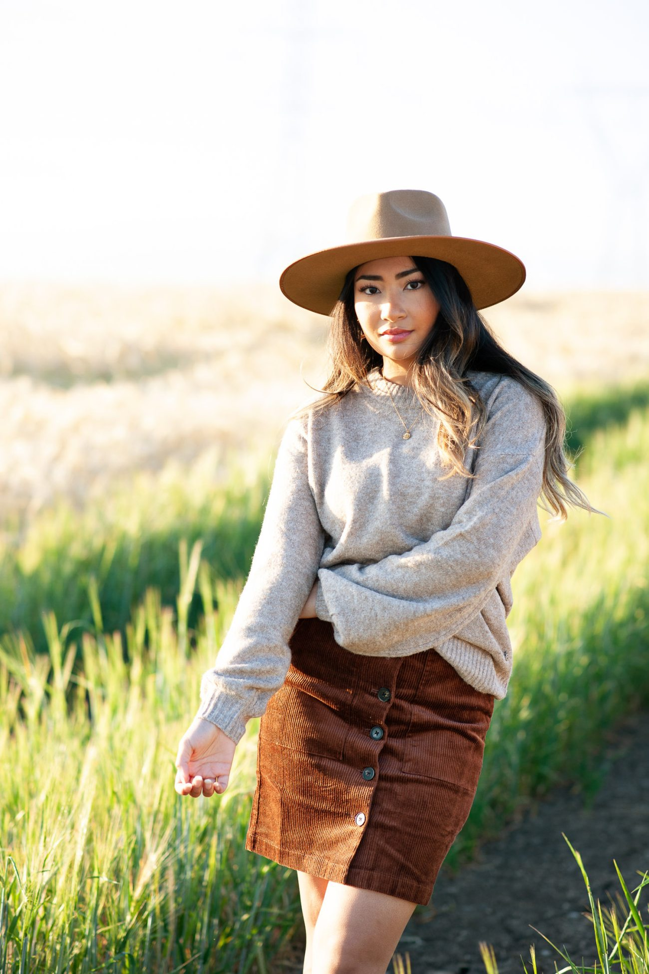 bride in a cozy sweater and hat for a fall engagement session with Tara Whittaker Photography