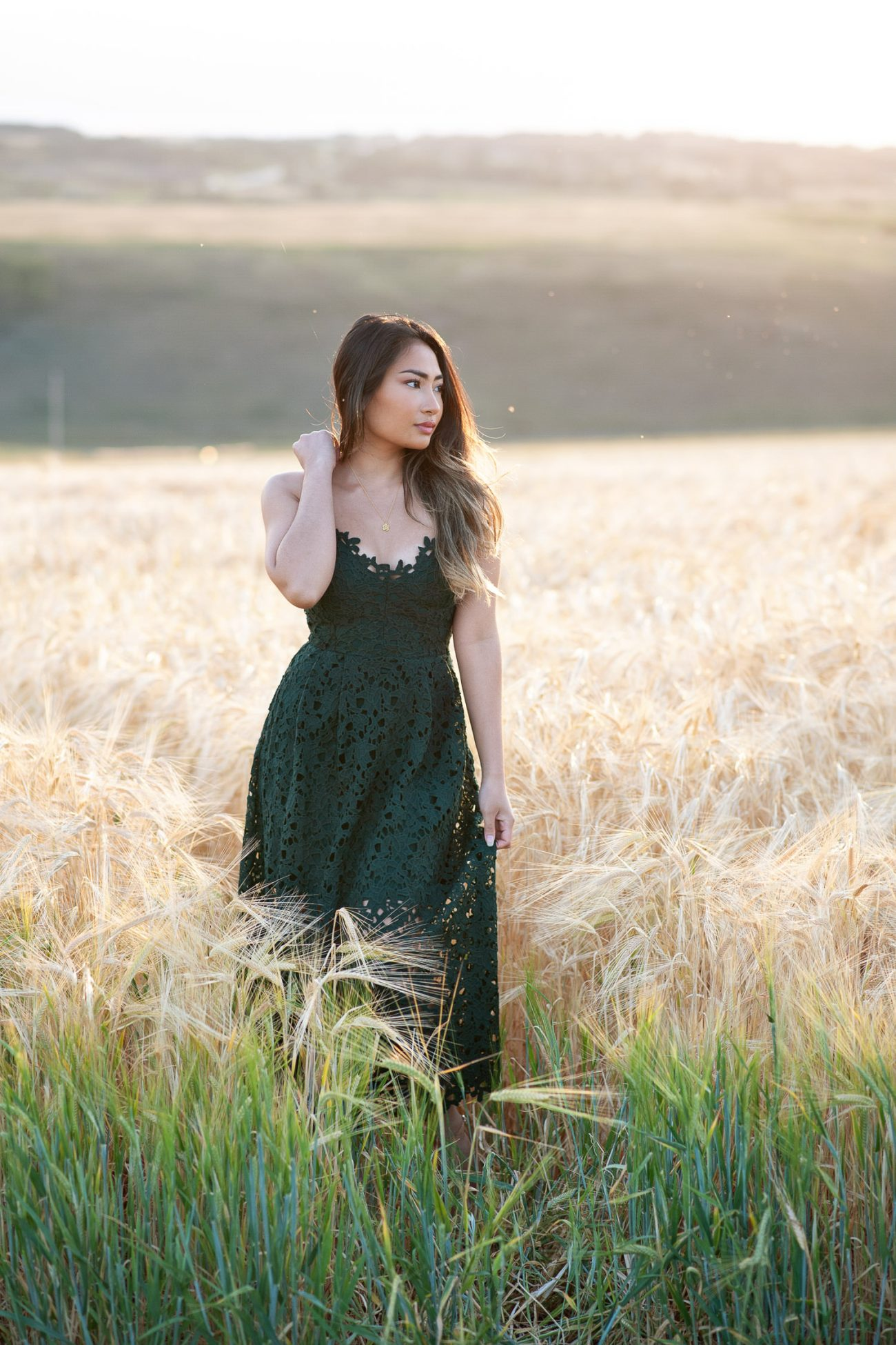 bride wears a green dress for a fall engagement captured by Tara Whittaker Photography