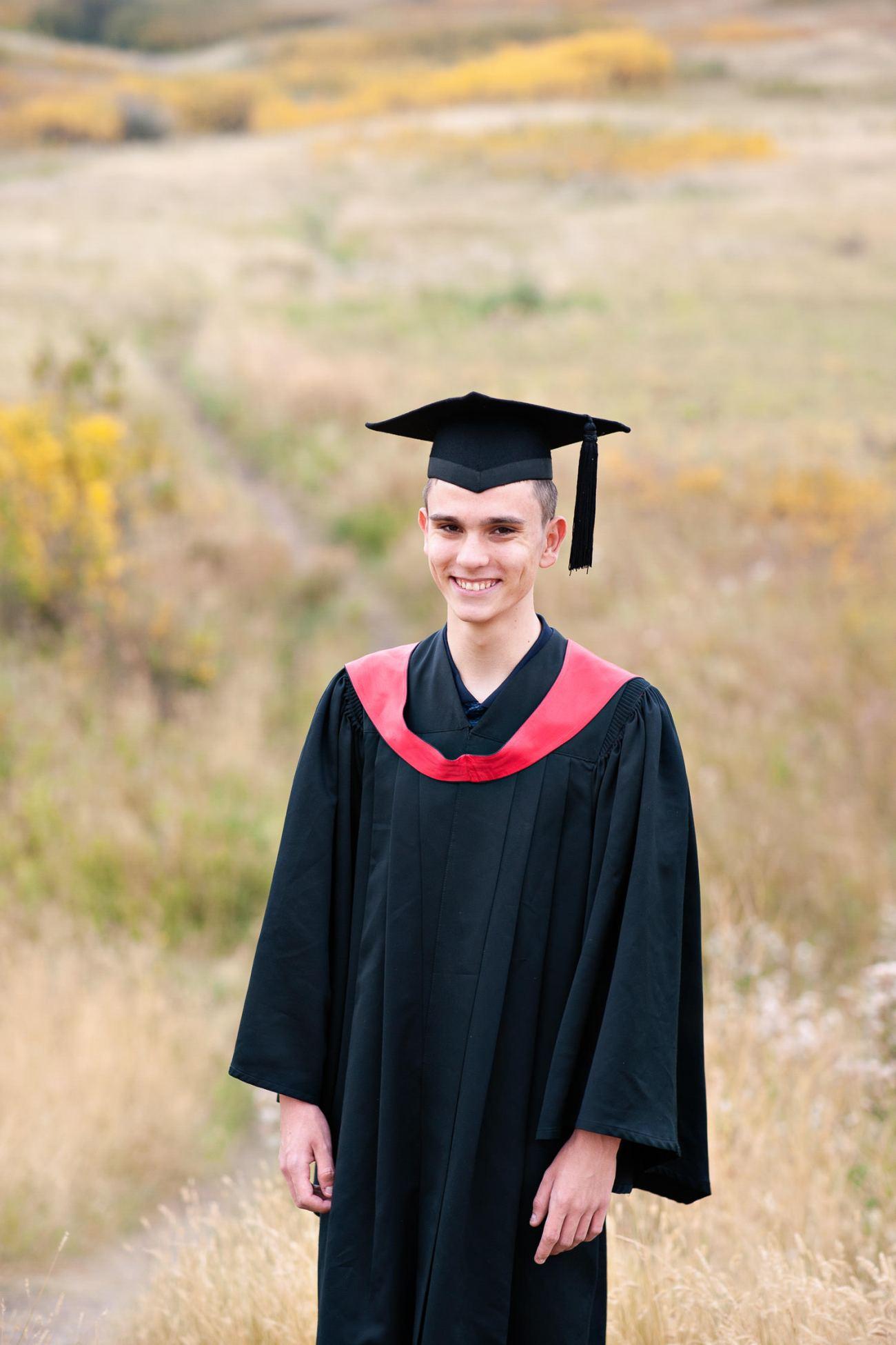 Calgary grad in cap and gown captured by Calgary photographer Tara Whittaker